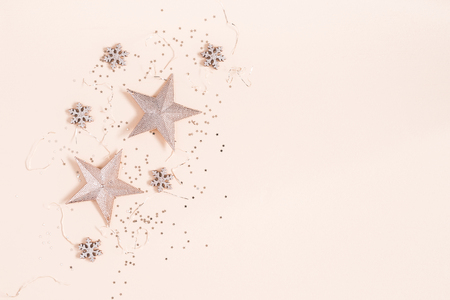 Christmas composition. Christmas decorations on pastel beige background. Flat lay, top view, copy space Stock Photo