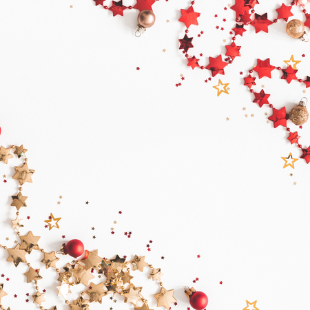Christmas composition. Christmas red and golden decorations on white background. Flat lay, top view, copy space, square