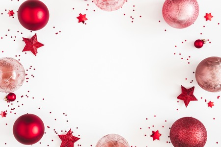 Christmas composition. Christmas red and pink decorations on white background. Flat lay, top view, copy space Stock Photo
