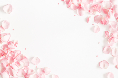 Flowers composition. Rose flower petals on white background. Valentines Day, Mothers Day concept. Flat lay, top view, copy space