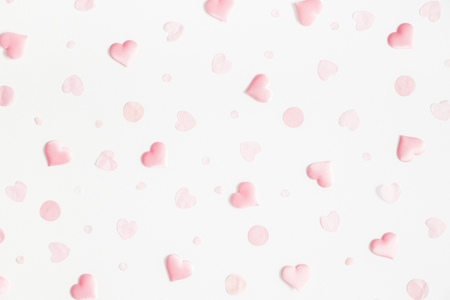 Valentines Day background. Pink hearts on white background. Valentines day concept. Flat lay, top view