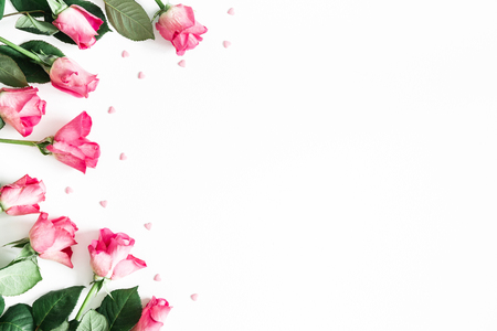 Flowers composition. Pink rose flowers on white background. Flat lay, top view, copy space