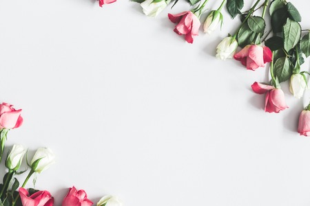Flowers composition. Pink and white rose flowers on pastel gray background. Flat lay, top view, copy space