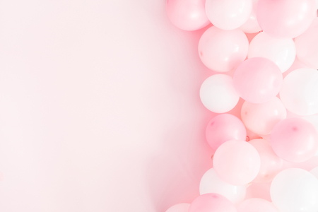 Balloons on pastel pink background. Frame made of white and pink balloons. Birthday, valentines day, holiday concept. Flat lay, top view, copy space Stok Fotoğraf