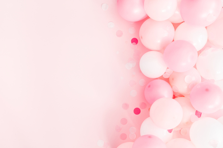 Balloons on pastel pink background. Frame made of white and pink balloons. Birthday, valentines day, holiday concept. Flat lay, top view, copy space Stock Photo