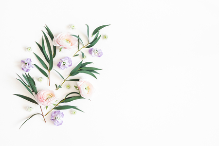 Flowers composition. Purple flowers and eucalyptus leaves on white background. Flat lay, top view, copy space