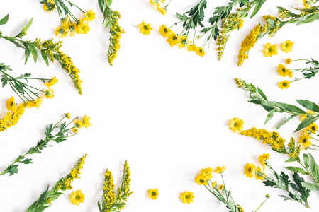 Flowers composition. Yellow flowers on white background. Spring, easter concept. Flat lay, top view, copy space