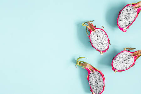 Summer fruits. Dragon fruits on blue background. Summer concept. Flat lay, top view, copy space