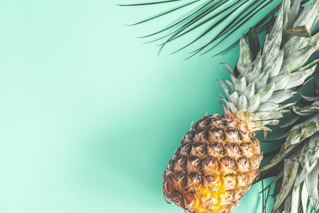 Pineapple on mint background. Summer concept. Flat lay, top view
