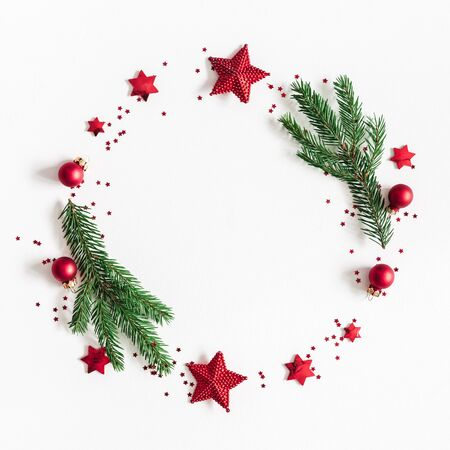 Christmas composition. Fir tree branches, red and green decorations on white background. Christmas, winter, new year concept. Flat lay, top view, copy space, square
