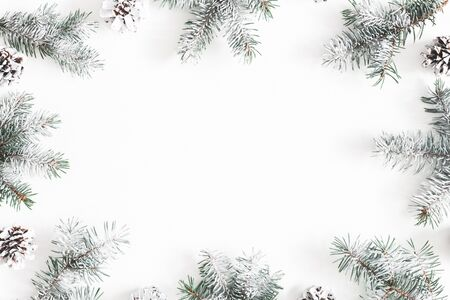 Christmas composition. Frame made of fir tree branches, pine cones on white background. Christmas, winter, new year concept. Flat lay, top view, copy space Stock Photo