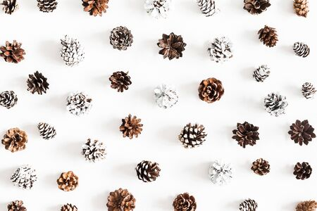 Christmas composition. Pattern made of pine cones on white background. Christmas, winter, new year concept. Flat lay, top view Stock Photo