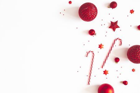 Christmas composition. Red decorations on white background. Christmas, winter, new year concept. Flat lay, top view, copy space
