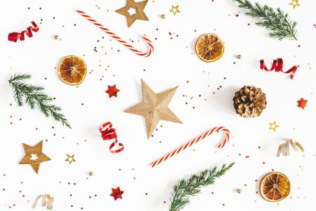 Christmas composition. Fir tree branches, golden and red decorations on white background. Christmas, winter, new year concept. Flat lay, top view