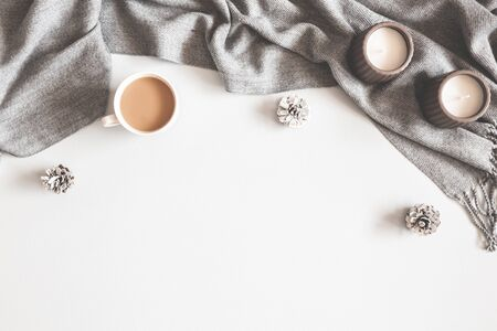 Christmas composition. Cup of coffee, scarf on gray background. Christmas, winter concept. Flat lay, top view, copy space