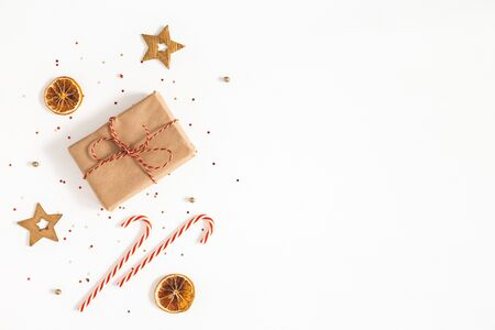 Christmas composition. Gift box, golden decorations on white background. Christmas, winter, new year concept. Flat lay, top view, copy space