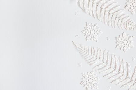 Christmas composition. Frame made of snowflakes on pastel gray background. Christmas, winter, new year concept. Flat lay, top view, copy space