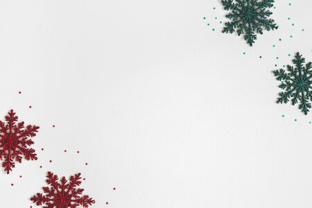 Christmas or winter composition. Frame made of colorful snowflakes on pastel gray background. Christmas, winter, new year concept. Flat lay, top view, copy space