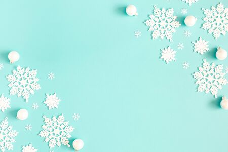 Christmas or winter composition. Pattern made of snowflakes on pastel blue background. Christmas, winter, new year concept. Flat lay, top view, copy space