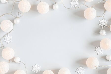 Christmas composition. Garland, christmas decorations on gray background. Christmas, winter concept. Flat lay, top view, copy space
