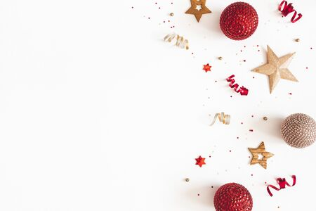 Christmas composition. Red and golden decorations on white background. Christmas, winter, new year concept. Flat lay, top view, copy space Zdjęcie Seryjne