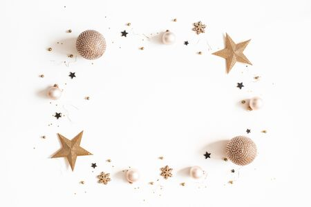 Christmas composition. Golden and black decorations on white background. Christmas, winter, new year concept. Flat lay, top view, copy space