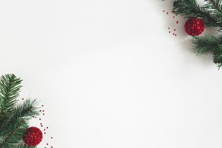 Christmas composition. Fir tree branches, red balls on gray background. Christmas, winter, new year concept. Flat lay, top view, copy space