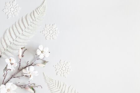 Christmas composition. White decorations on pastel gray background. Christmas, winter, new year concept. Flat lay, top view, copy space