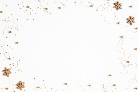 Christmas composition. Golden decorations on white background. Christmas, winter, new year concept. Flat lay, top view, copy space Zdjęcie Seryjne