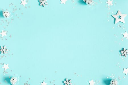 Christmas composition. Silver decorations on pastel blue background. Christmas, winter, new year concept. Flat lay, top view, copy space