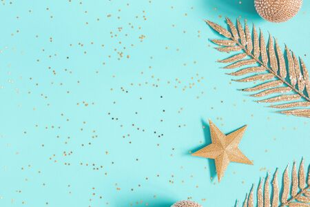 Christmas composition. Golden decorations on blue background. Christmas, winter, new year concept. Flat lay, top view, copy space