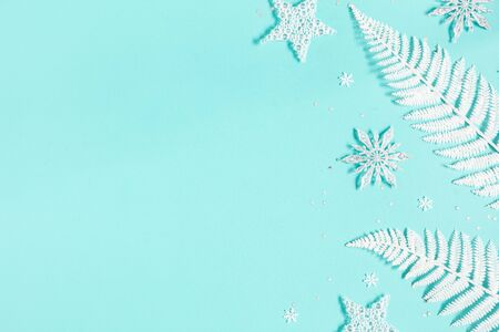 Christmas composition. White decorations on pastel blue background. Christmas, winter, new year concept. Flat lay, top view, copy space
