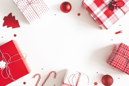 Christmas composition. Gift box, christmas decorations on white background. Flat lay, top view, copy space
