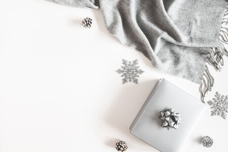 Christmas composition. Gift box, silver decorations, plaid on white background. Christmas, winter, new year concept. Flat lay, top view, copy space Zdjęcie Seryjne