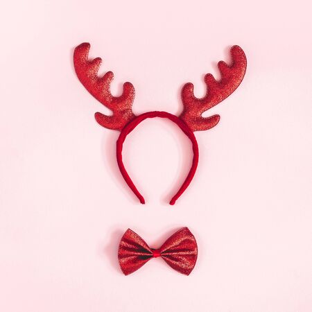 Christmas decoration. Christmas deer decoration on pink background. Flat lay, top view, square