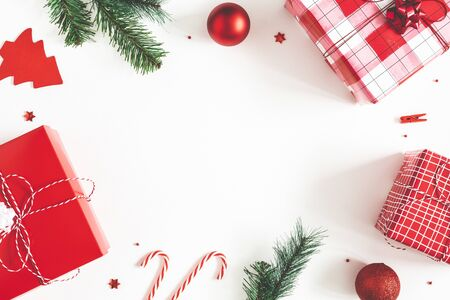 Christmas composition. Gift box, fir tree branches, christmas decorations on white background. Flat lay, top view, copy space