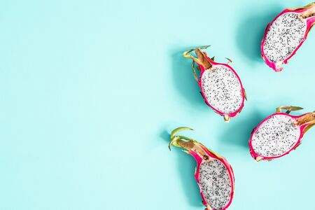 Summer fruits. Dragon fruits on blue background. Summer concept. Flat lay, top view