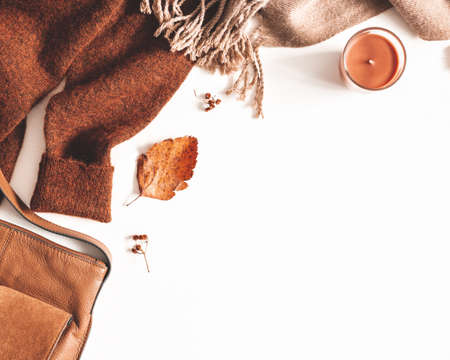 Autumn composition. Sweater, plaid, autumn leaves on white background. Flat lay, top view