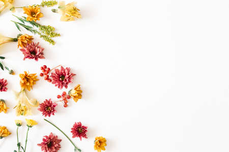 Autumn floral composition. Frame made of fresh flowers on white background. Autumn, fall concept. Flat lay, top view, copy space Stock fotó