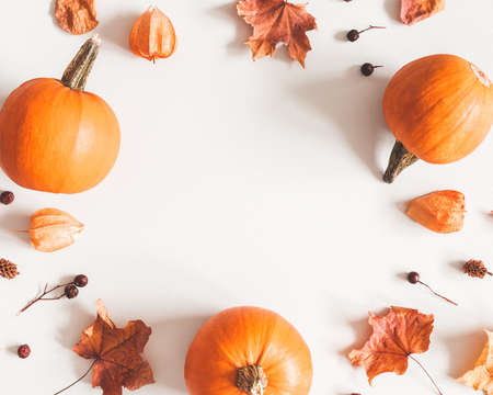 Autumn composition. Pumpkins, candles, dried leaves on white background. Autumn, fall, halloween concept. Flat lay, top view, copy space Stock fotó