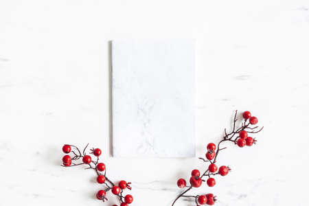 Christmas composition. Marble paper blank, res berries on marble background. Christmas, winter, new year concept. Flat lay, top view Stock fotó