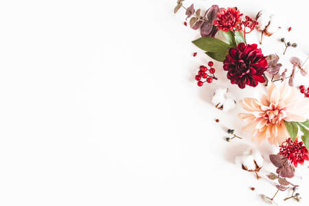 Autumn composition. Dried flowers and leaves on white background. Autumn, fall, thanksgiving day concept. Flat lay, top view