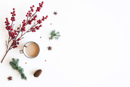 Autumn composition. Cup of coffee, fir tree branches, berries on white background. Christmas, winter concept. Flat lay, top view Stock fotó