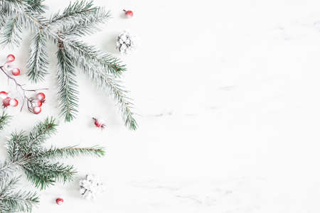 Christmas composition. Fir tree branches on marble background. Christmas, winter, new year concept. Flat lay, top view, copy space