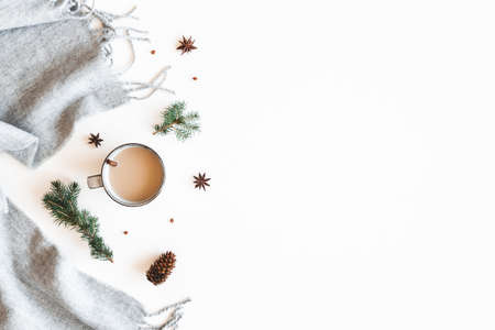 Christmas composition. Cup of coffee, fir tree branches, plaid on white background. Christmas, winter, new year concept. Flat lay, top view