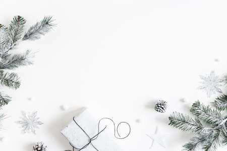 Christmas composition. Gift box, fir tree branches, decorations on white background. Christmas, winter, new year concept. Flat lay, top view, copy space Stock fotó