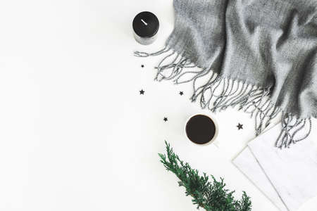 Christmas decorations, plaid, fir tree branch, notebook, cup of coffee on white background. Christmas, new year, winter concept. Flat lay, top view