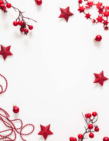 Christmas red decorations on white background. Christmas, new year, winter concept. Flat lay, top view, copy space