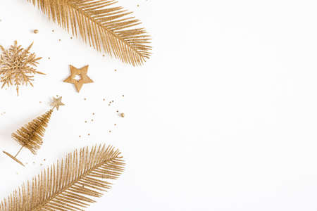 Christmas composition. Golden decorations on white background. Christmas, winter, new year concept. Flat lay, top view, copy space Stock fotó