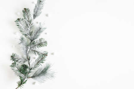Christmas composition. Fir tree branches on white background. Christmas, winter, new year concept. Flat lay, top view, copy space